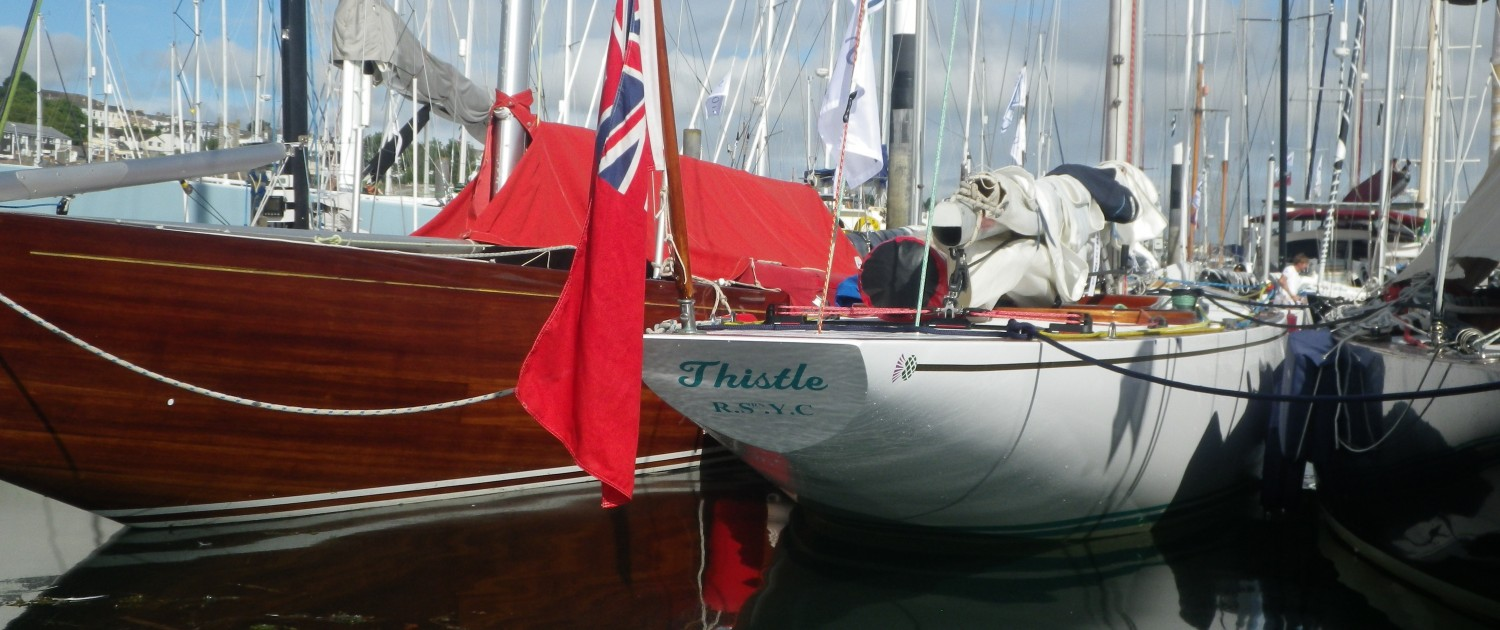 Thistle 6m classic sailing yacht in the water