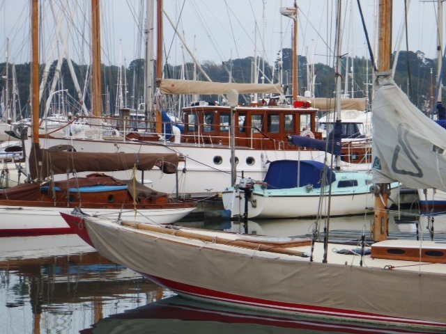 moorings at the yard with classic sailing yachts and motor cruisers